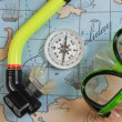 Mask and snorkel diving on map — Stock Photo