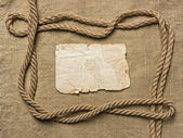 Old paper and rope on canvas — Stock Photo