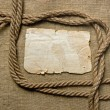 Foto de Stock  : Old paper and rope on canvas