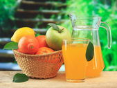 Basket of fruit and juice — Stock Photo