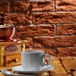 Coffee grinder and cup on table — Stock Photo #10051973
