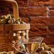 Peanuts in basket and on the table — Stock Photo