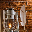 Composition of old writing items and kerosene lamp - Stock Photo