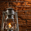 Kerosene lamp on brick background — Stock fotografie