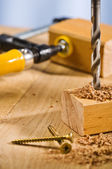 Drilling hole in a wooden plank. — Stock Photo