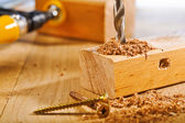 Drilling of wooden board — Stock Photo