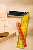 Set-square ruler and pencil with boards — Stock Photo