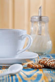 Cup dispencer and cookies — Stock Photo