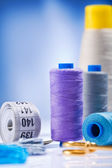 Sewing spools with threads and other items — Stock Photo
