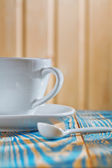 White coffee cup on the old wooden table — Stock Photo
