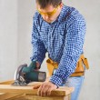 Royalty-Free Stock Photo: Single man cuts the board