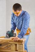 Single man cuts the board — Stock Photo