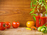 Composition of tomatoes and juice — Stock Photo
