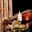 Old violin witn candle ond old scroll of paper - Photo