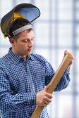 Carpenter take the wooden board — Stock Photo