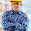 Worker on the blurred background of a department — Stock Photo #9876393