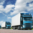 Стоковое фото: Convoy of trucks on highway, cargo transportation concept