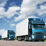 Convoy of trucks on highway, cargo transportation concept — Stock Photo