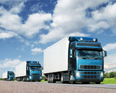 Convoy of trucks on highway, cargo transportation concept — Стоковое фото