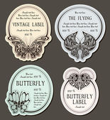 Set of labels with butterflies — Stock Vector
