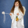 Child dressed as an angel with a magic wand — Stock Photo
