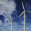 Royalty-Free Stock Photo: Wind turbines against a blue sky