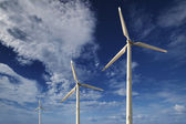 Wind turbines against a blue sky — Foto Stock