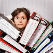 Accountant swamped with financial documents — Stok fotoğraf