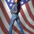 Young woman in jeans with American flag — Stock Photo