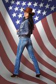 Jeune femme en jeans avec drapeau américain — Photo