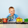 Boy playing with toy railroad — Stock Photo