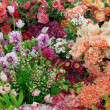 Background from artificial flowers — Stock Photo #9088618