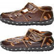 Kids brown leather sandals on white — Stock Photo #9134212