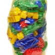 New plastic toy blocks in the bag — Stock Photo