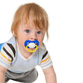 Attentive baby with a pacifier — Stock Photo