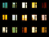 Windows noche - bloque de fondo pisos — Foto de Stock