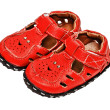 Small red leather sandals for a child — Stock Photo
