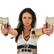 Young woman posing with two pistols — Stock Photo