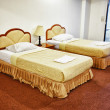 Stock Photo: Two beds in interior of hotel