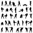 Royalty-Free Stock Vector Image: Silhouettes of the fighting men - vector set.