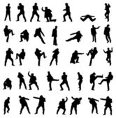 Silhouettes of the fighting men - vector set. — Stock Vector