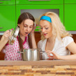 Girls looking at a meal in a pot — Stock Photo