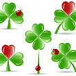 Vector illustration of set of   shamrocks with four lucky leaves — Imagens vectoriais em stock