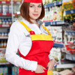 The woman seller in food supermarket — Stock Photo