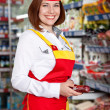 The woman seller in food supermarket - Stock Photo