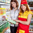 Stock Photo: The seller and the buyer in grocery shop