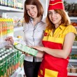 The seller and the buyer in grocery shop - Stock Photo