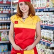 Portrait woman seller in food supermarket - Stock Photo