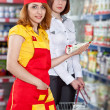 The seller and the buyer in grocery shop — Stock Photo #10691457