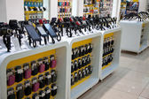 Digital cameras and mobil phones in store — Stock Photo